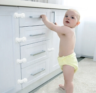Child-Proof Cabinet Latches tp Keep Curious Toddlers Away from Cabinets